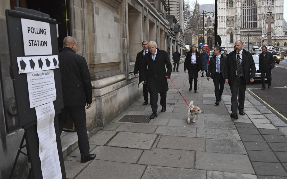 Britain's Prime Minister and Conservative Party leader Boris Johnson with his dog Dilyn arrives to cast his vote in the general election at Methodist Central Hall, Westminster, London, on Thursday. — AP