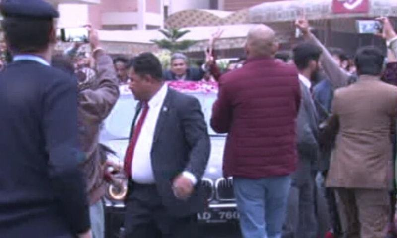 A car carrying PPP leader Asif Ali Zardari is surrounded by supporters while leaving Pims. — DawnNewsTV