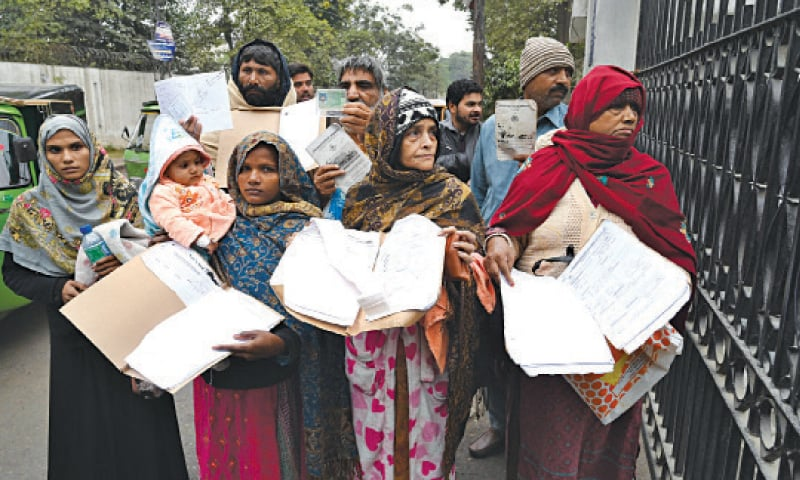 Heart patients visiting the Punjab Institute of Cardiology show their documents for getting medicines. — White Star