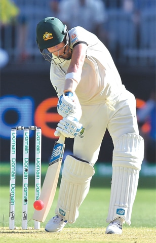 AUSTRALIAN batsman Steve Smith plays a shot during the first Test against New Zealand at the Perth Stadium on Thursday.—AFP