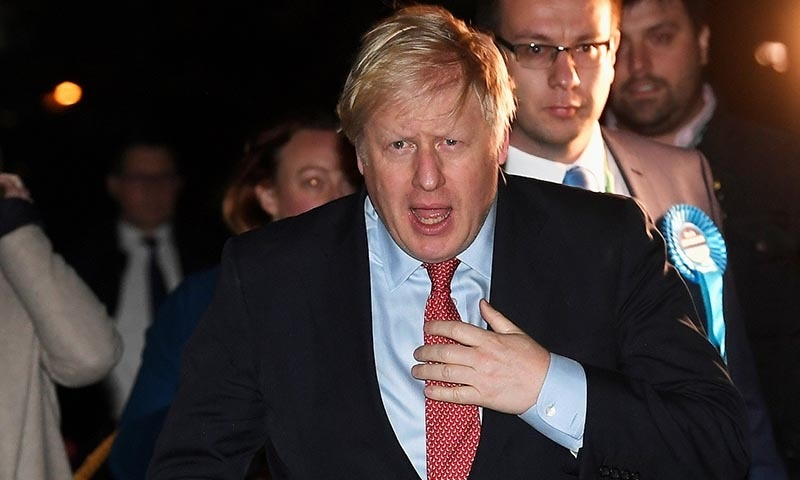 British Prime Minister Boris Johnson arrives at the counting centre in Britain's general election in Uxbridge, Britain on December 13. — Reuters