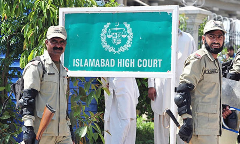Islamabad High Court Bar Secretary Mohammad Umair Baloch entered the courtroom of Chief Justice Athar Minallah and started forcing lawyers to leave the courtroom because of his strike call. — AFP/File