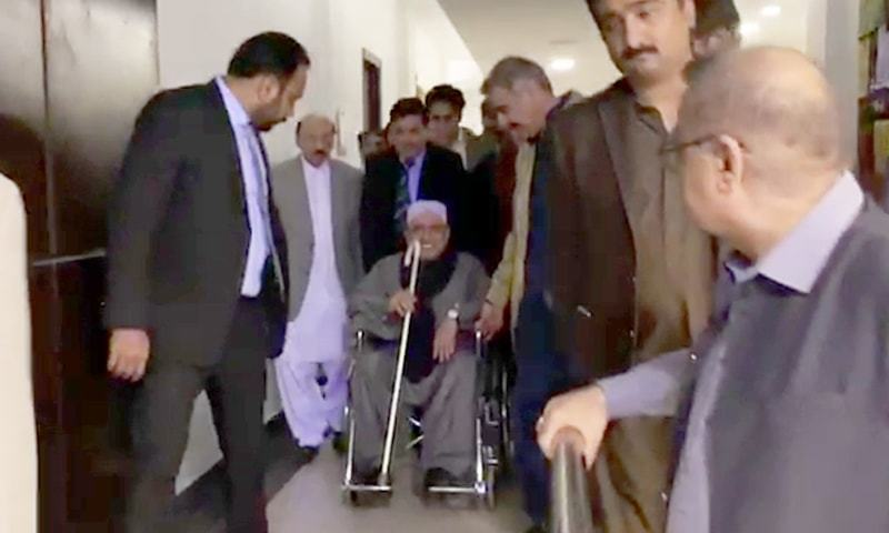 PPP co-chairperson Asif Ali Zardari comes out of the airport in Karachi on a wheelchair. — DawnNewsTV