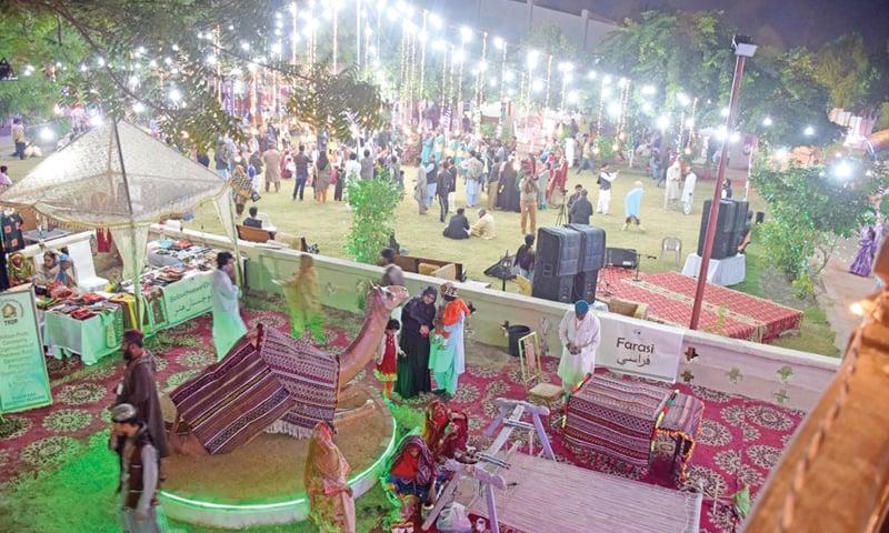 ARTISANS display their handicrafts at the festival under way at Sindh Museum in Hyderabad.—Dawn