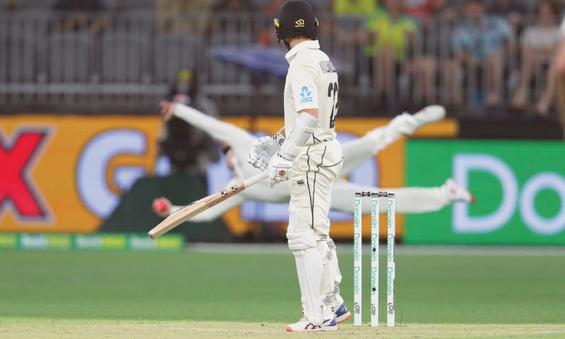 NEW ZEALAND batsman Kane Williamson looks behind to see Australia's Steve Smith dive horizontally to his right at second slip and take a spectacular one-handed catch to dismiss him during the first Test at the Perth Stadium on Friday.—AP