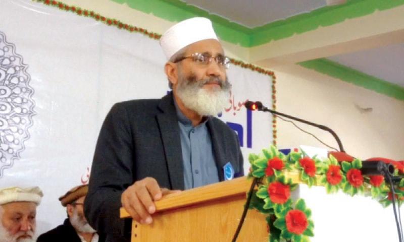 Sirajul Haq addresses a function in Swabi on Friday. —Dawn