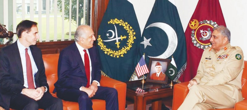 RAWALPINDI: Chief of the Army Staff Gen Qamar Javed Bajwa exchanging views with US Special Envoy Zalmay Khalilzad during a meeting at GHQ on Friday.—PPI