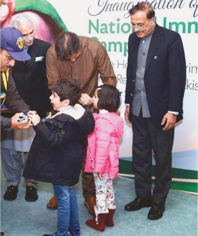ISLAMABAD: Prime Minister Imran Khan administering polio vaccine to a child during the launch ceremony of Nationwide Polio Eradication Campaign.—APP