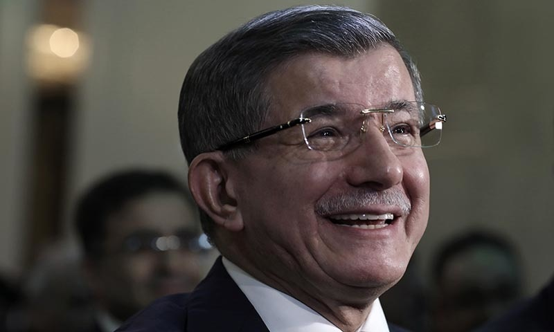 "Former Turkish Prime Minister Ahmet Davutoglu smiles before addressing his supporters after he launched ""The Future Party,"" a splinter party to rival President Recep Tayyip Erdogan, in Ankara, Turkey, on Friday. — AP"