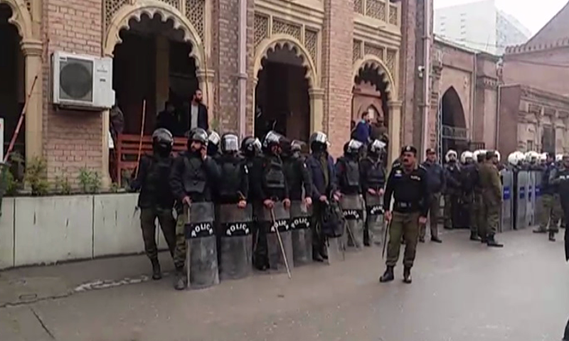 A large contingent of police outside the Lahore High Court on Friday. — DawnNewsTV