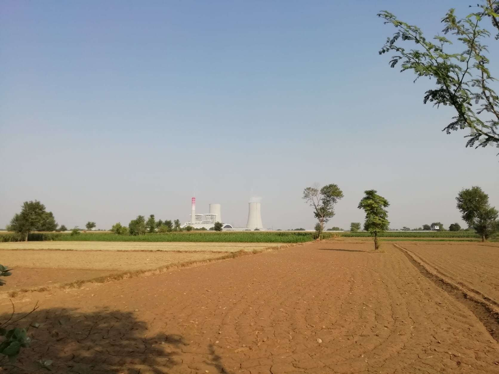 The coal power plant stands in the middle of Sahiwal's agricultural land