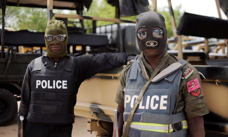 This picture taken on June 5, 2013 shows Nigerian police part of the joint forces in Borno state posing prior to a patrol in Maiduguri. — AFP/file