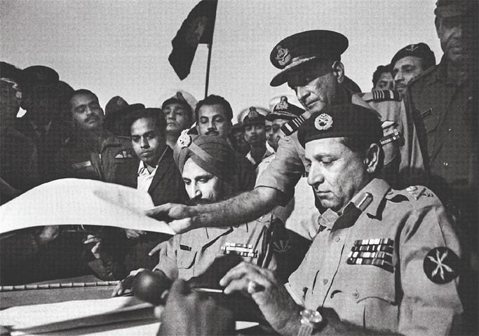Gen Niazi (right) signs the Treaty of Surrender on December 16, 1971 | Raghu Rai/File photo