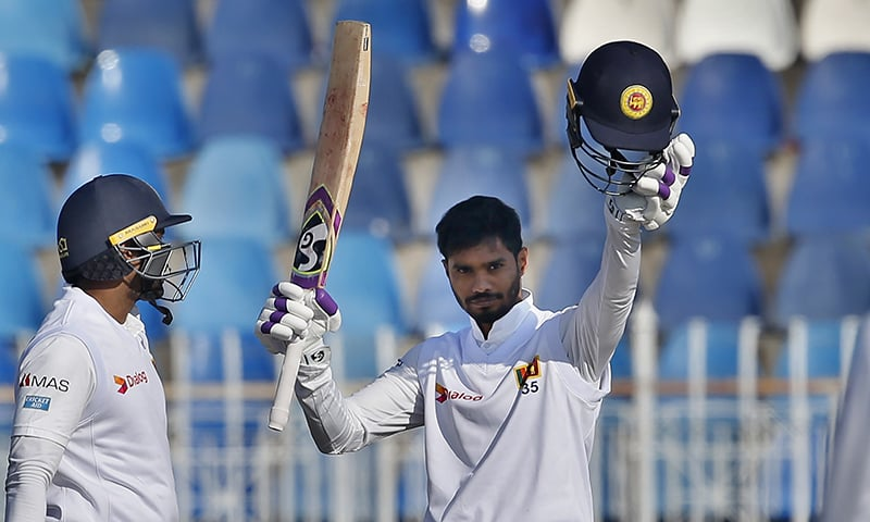 Sri Lankan batsman Dhananjaya de Silva (R) celebrates after completing his century during the fifth day of the 1st cricket test match between Pakistan and Sri Lanka, in Rawalpindi, on Sunday, December 15, 2019. — AP