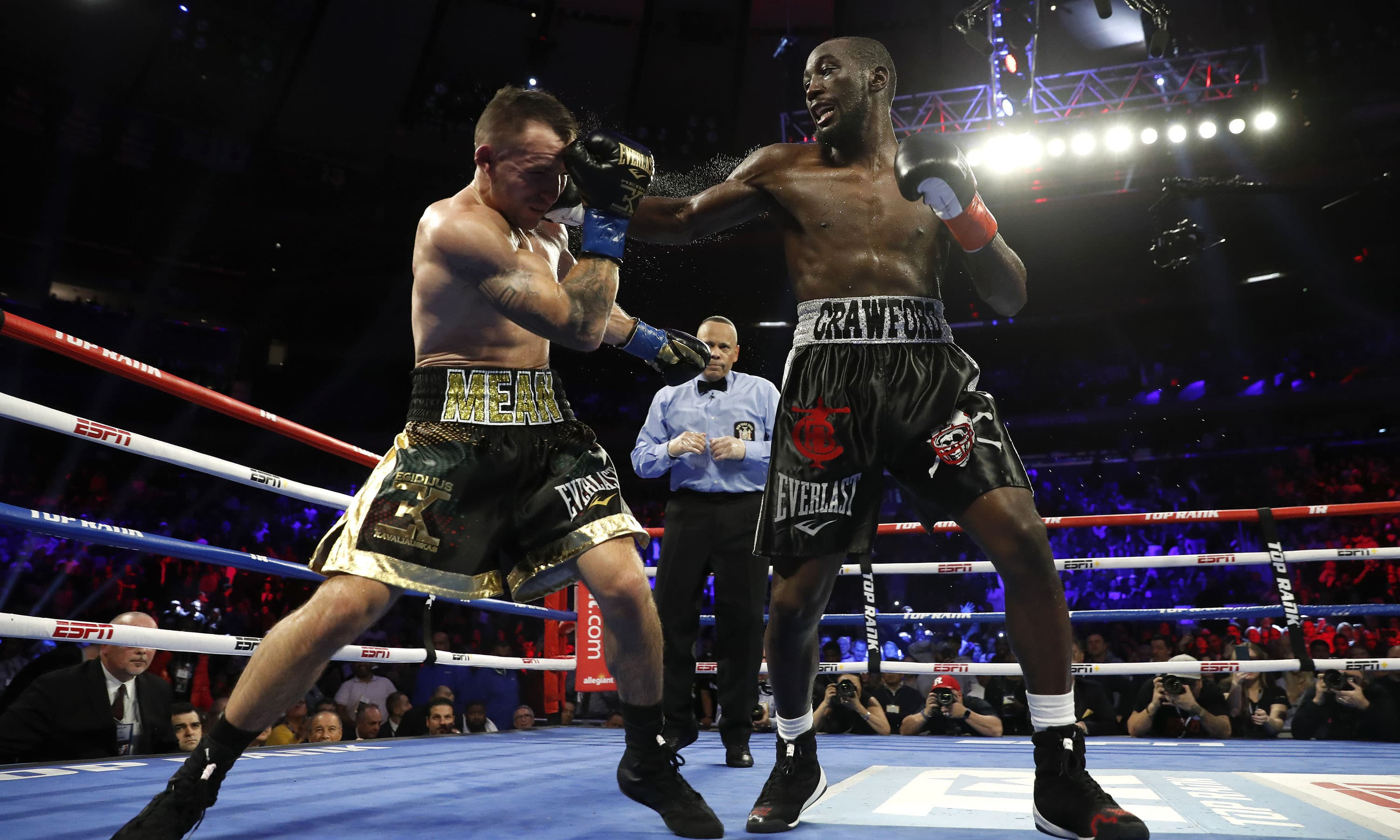 Terence Crawford, right, punches Lithuania's Egidijus Kavaliauskas, knocking him down for a TKO in the ninth round of a WBO welterweight boxing match on Dec 14. — AP