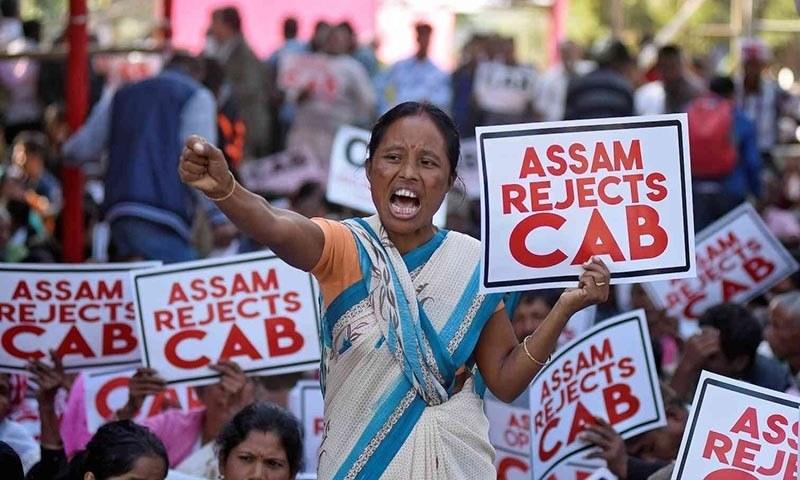A woman shouts slogans during a protest against the Citizenship Amendment Bill. — Reuters/File