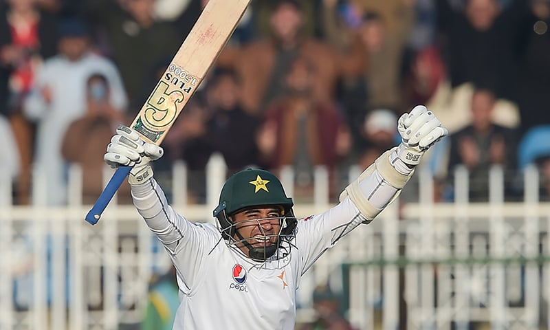 Pakistan's Abid Ali celebrates after scoring a century (100 runs) during the fifth and final day of the first Test cricket match between Pakistan and Sri Lanka at the Rawalpindi Cricket Stadium in Rawalpindi on December 15, 2019. (Photo by Aamir QURESHI / AFP) — AFP or licensors