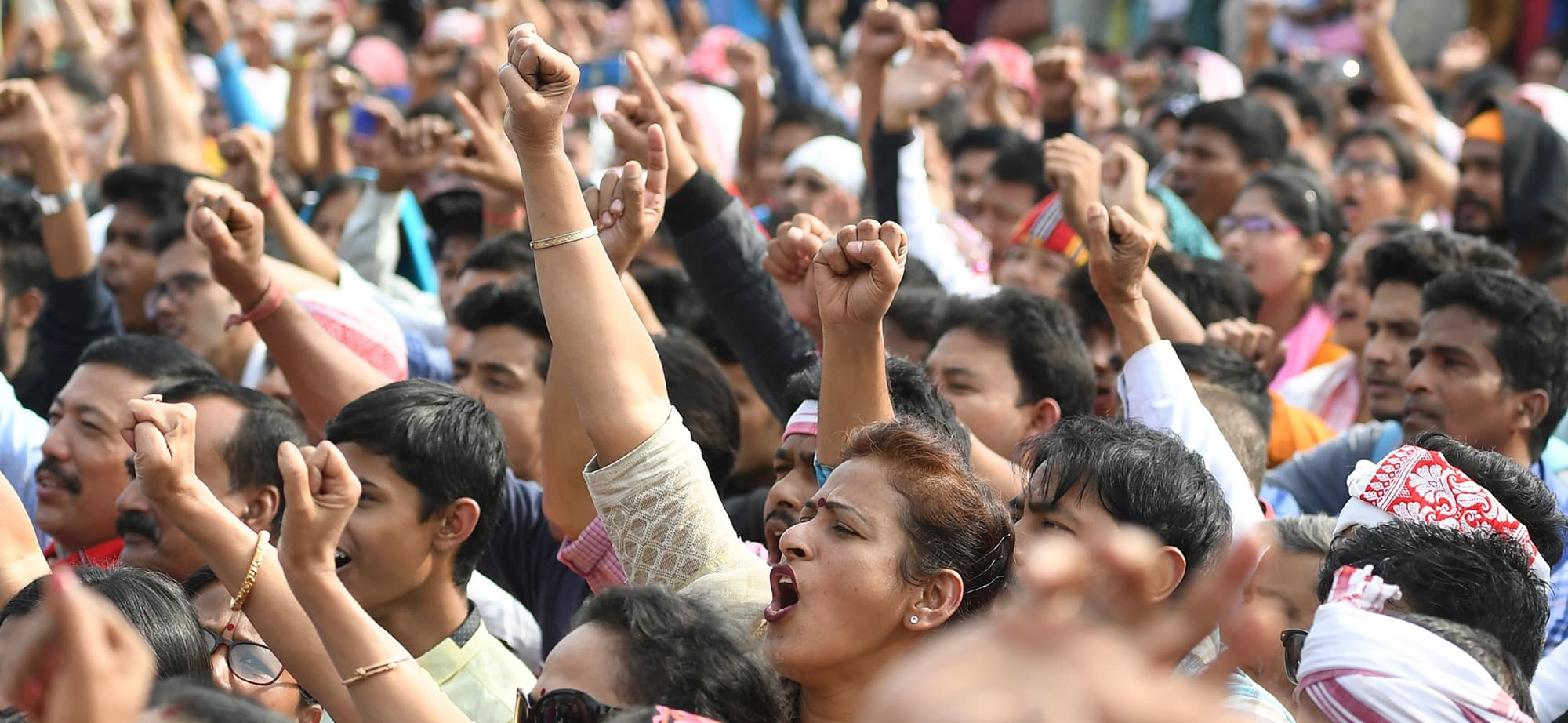 "Demonstrators take part in a musical concert to protest against Citizen Amendment Act (CAB) in Guhawati on December 15, 2019. - Some 5,000 people took part in a fresh demonstration in Guwahati on December 15, with hundreds of police watching on as they sang, chanted and carried banners with the words ""long live Assam"". (Photo by Sajjad HUSSAIN / AFP) — AFP or licensors"