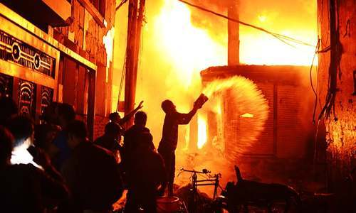 Firefighters and area residents help to douse a fire in Dhaka, Bangladesh. — AP/File