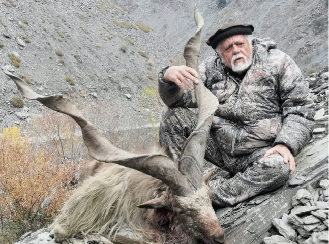 American trophy hunter Joe Lawrence Walreven with his prized kill in Toshi game reserve, Chitral. — Dawn