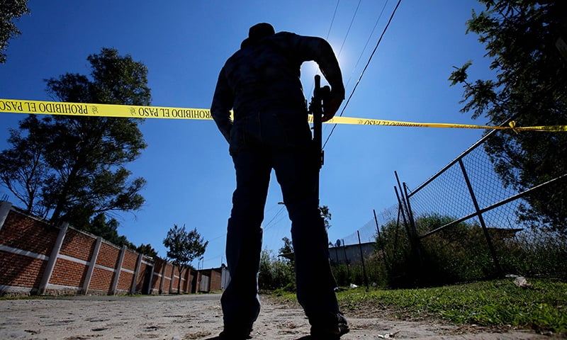 A staff member of the Specialized Prosecutor's Office for Missing Persons works at El Mirador neighborhood in Tlajomulco de Zuniga, Mexico on Nov 22. — AFP