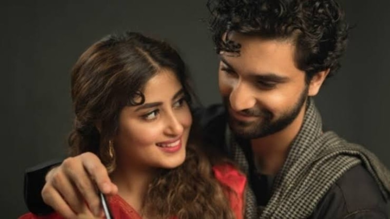 Pictured with his co-star and fiance, Sajal Aly in a still from Aangan.