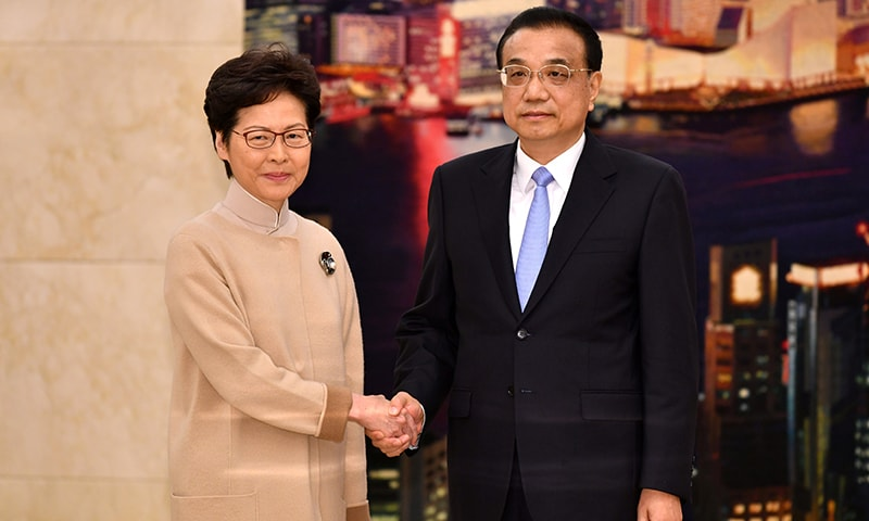 Hong Kong Chief Executive Carrie Lam shakes hands with Chinese Premier Li Keqiang during their meeting in Beijing, China on December 16, 2019. — Reuters