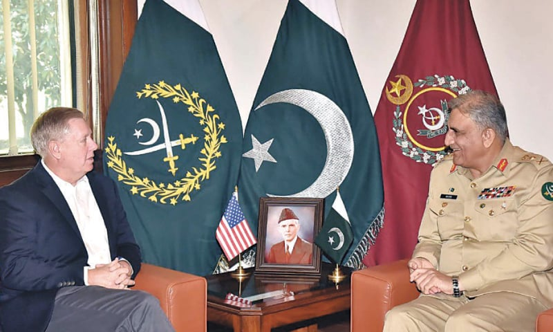 RAWALPINDI: Chief of the Army Staff Gen Qamar Javed Bajwa exchanges views with US Senator Lindsey Graham during a meeting at GHQ on Monday.—PPI