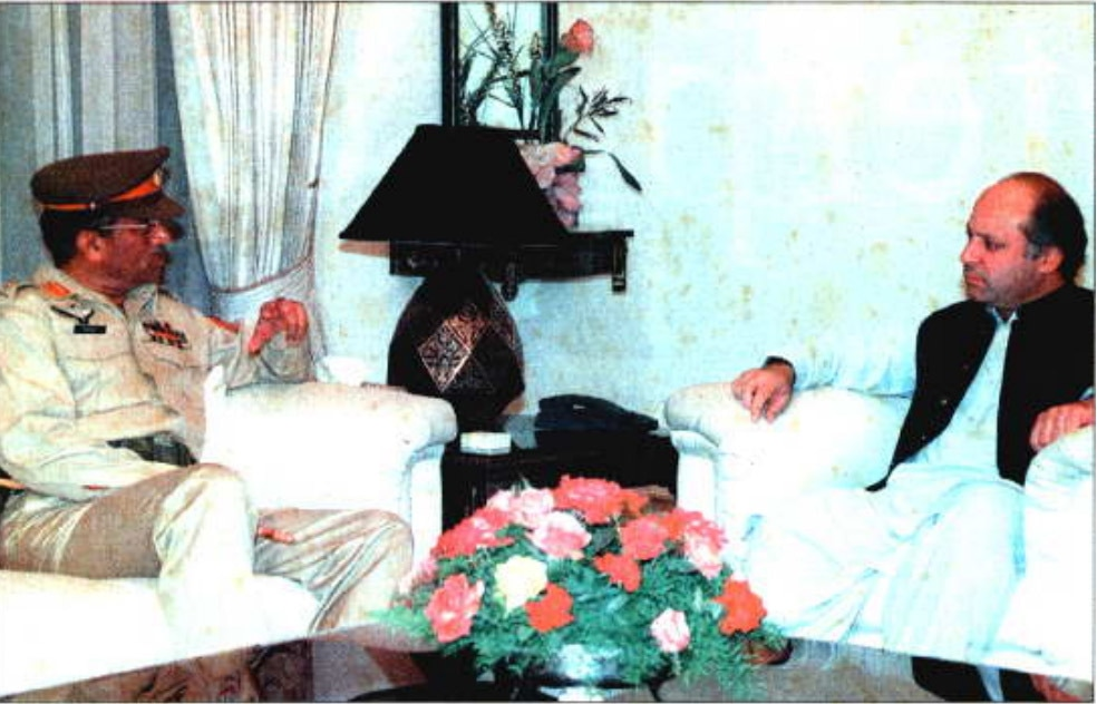 In this file photo from October 8, 1998, then prime minister Nawaz Sharif talks with the newly appointed Chief of Army Staff, General Pervez Musharraf. — AFP