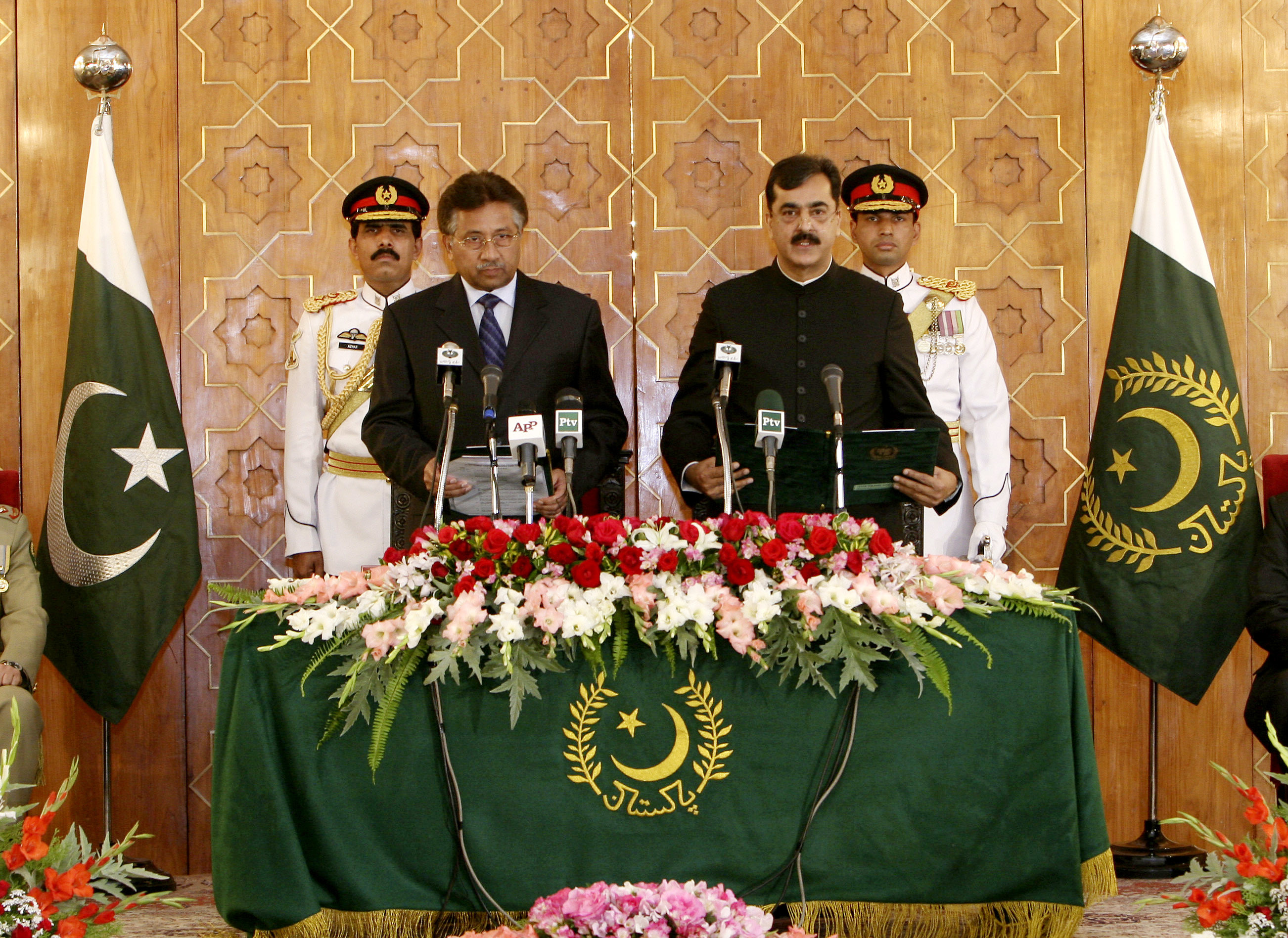 President Pervez Musharraf, front left, administers oath to newly-elected Prime Minister Yousaf Raza Gilani, front right, at Presidential Palace in Islamabad, March 25, 2008. — AP