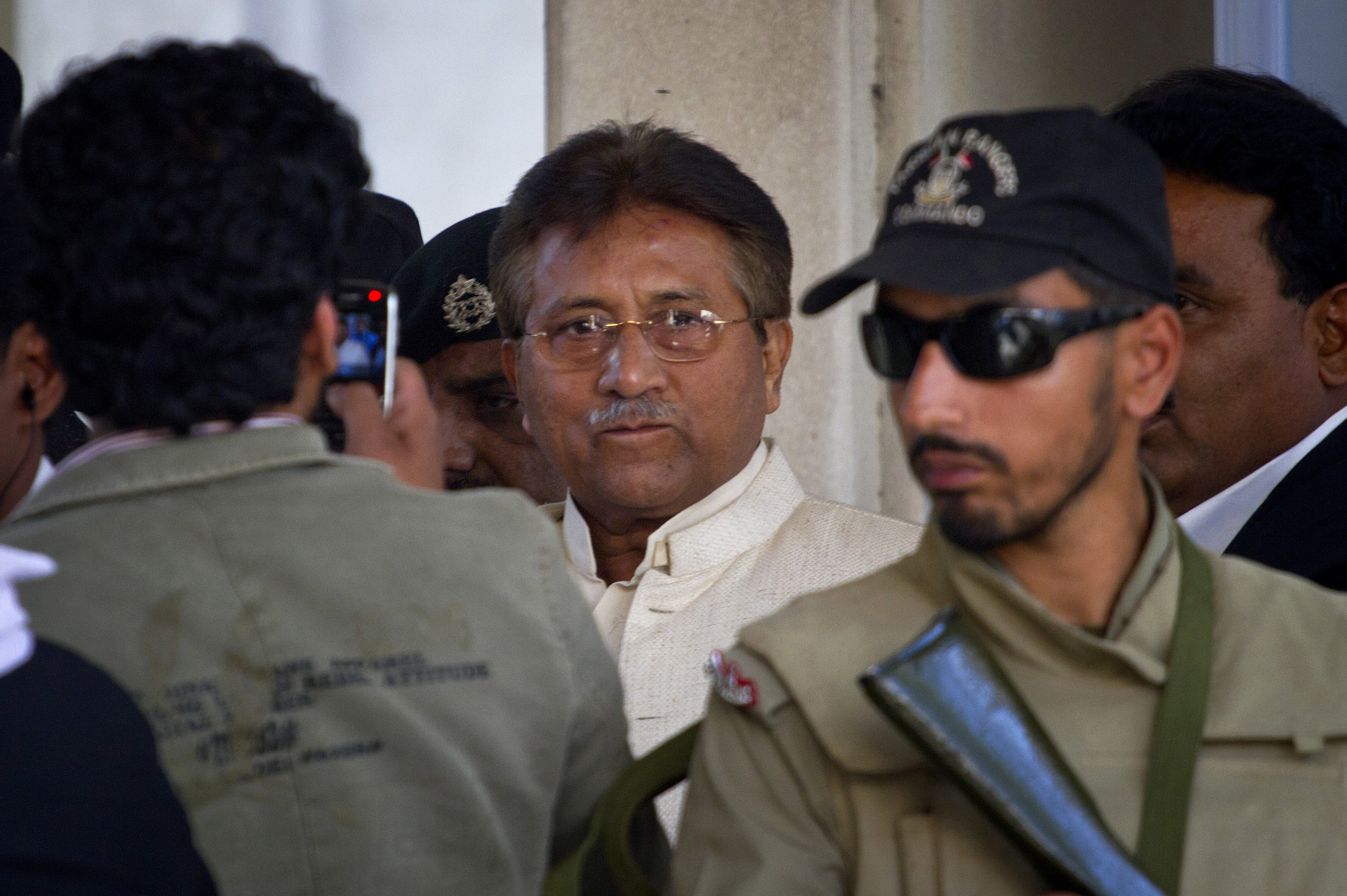 Musharraf leaves after appearing in court in Rawalpindi, April 17, 2013. Musharraf appeared in court to seek bail in Benazir Bhutto's assassination case. The Supreme Court ordered Musharraf to respond to allegations that he committed treason while in power, and barred him from leaving the country only weeks after he returned. — AP