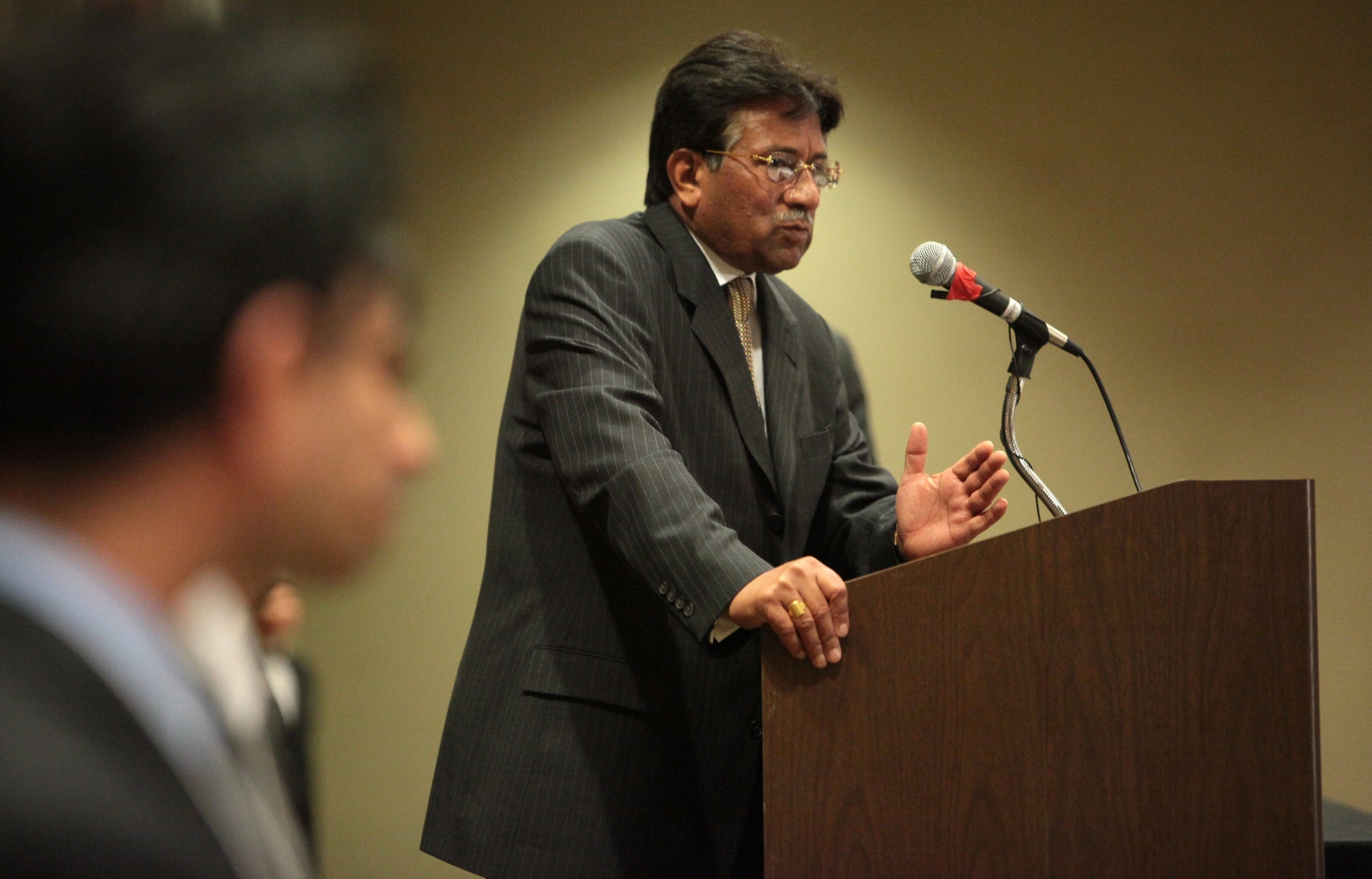 Former president Musharraf speaks during an event at the Westin Hotel in Bellevue, Washington on March 14, 2010. The former president spoke for almost an hour and took questions from the audience. — AP