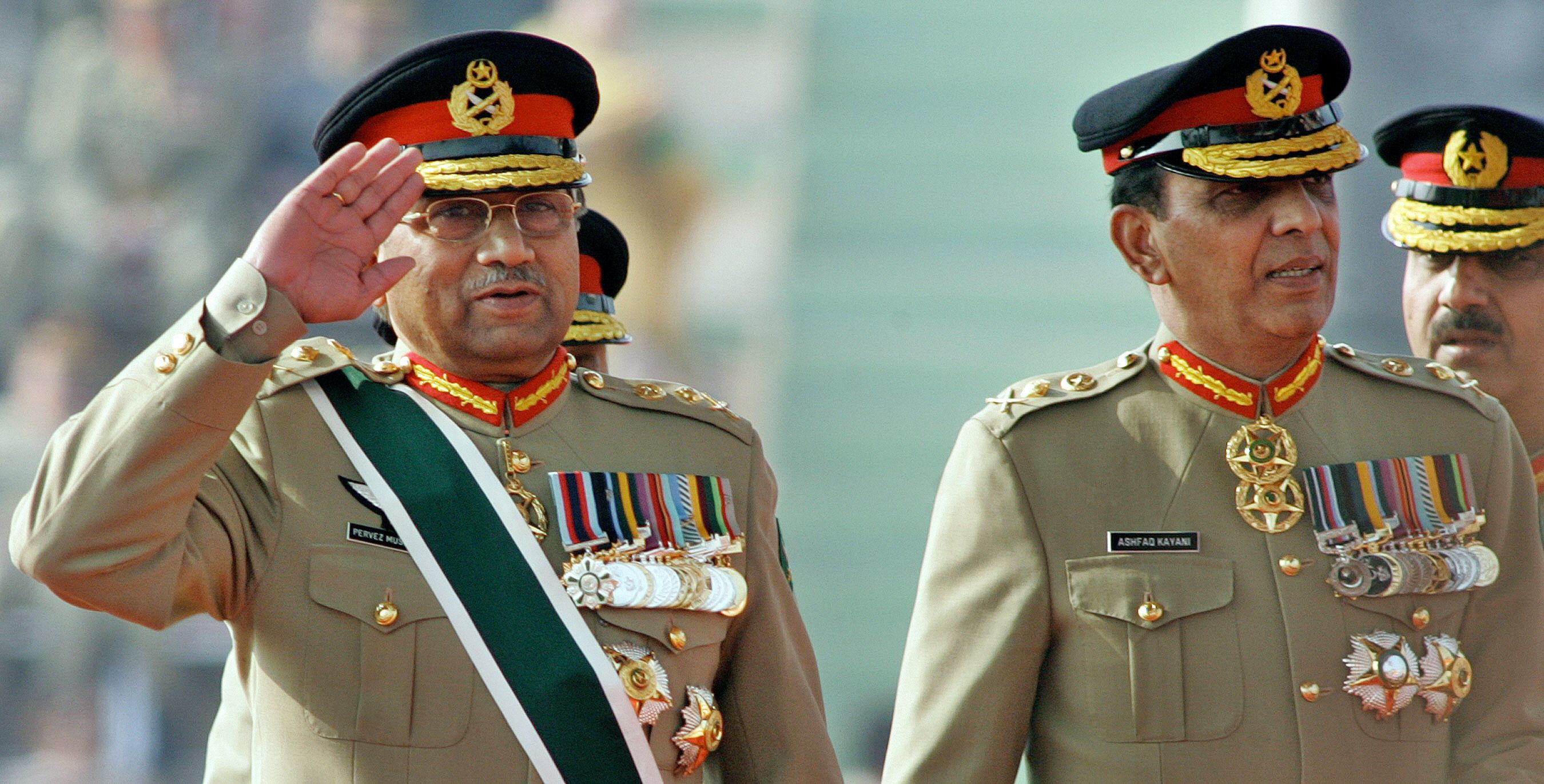 In this photograph taken on November 28, 2007, then President Pervez Musharraf (L) salutes as he arrives with then newly appointed army chief General Ashfaq Kiyani during the change of command ceremony in Rawalpindi.