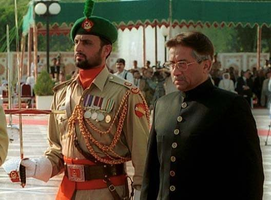 Musharraf reviews the guard of honour as he is sworn in as president in Islamabad, June 20, 2001. — AP