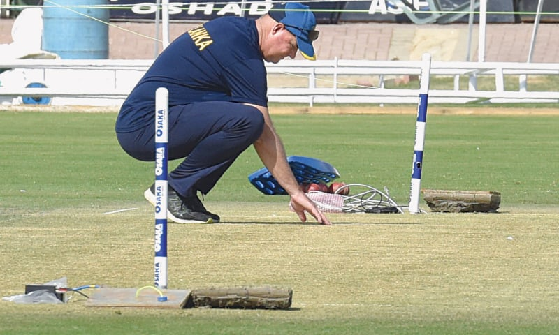 SRI LANKA head coach Mickey Arthur assesses the pitch ahead of the second Test against Pakistan.—Tahir Jamal/White Star