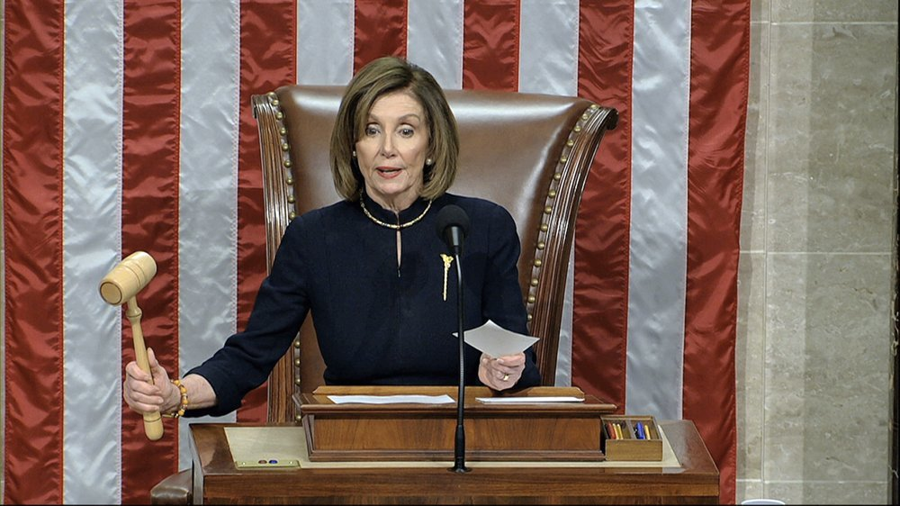 US House Speaker Nancy Pelosi announces the passage of the first article of impeachment, abuse of power, against President Donald Trump by the House of Representatives at the Capitol in Washington on Wednesday. ─ AP