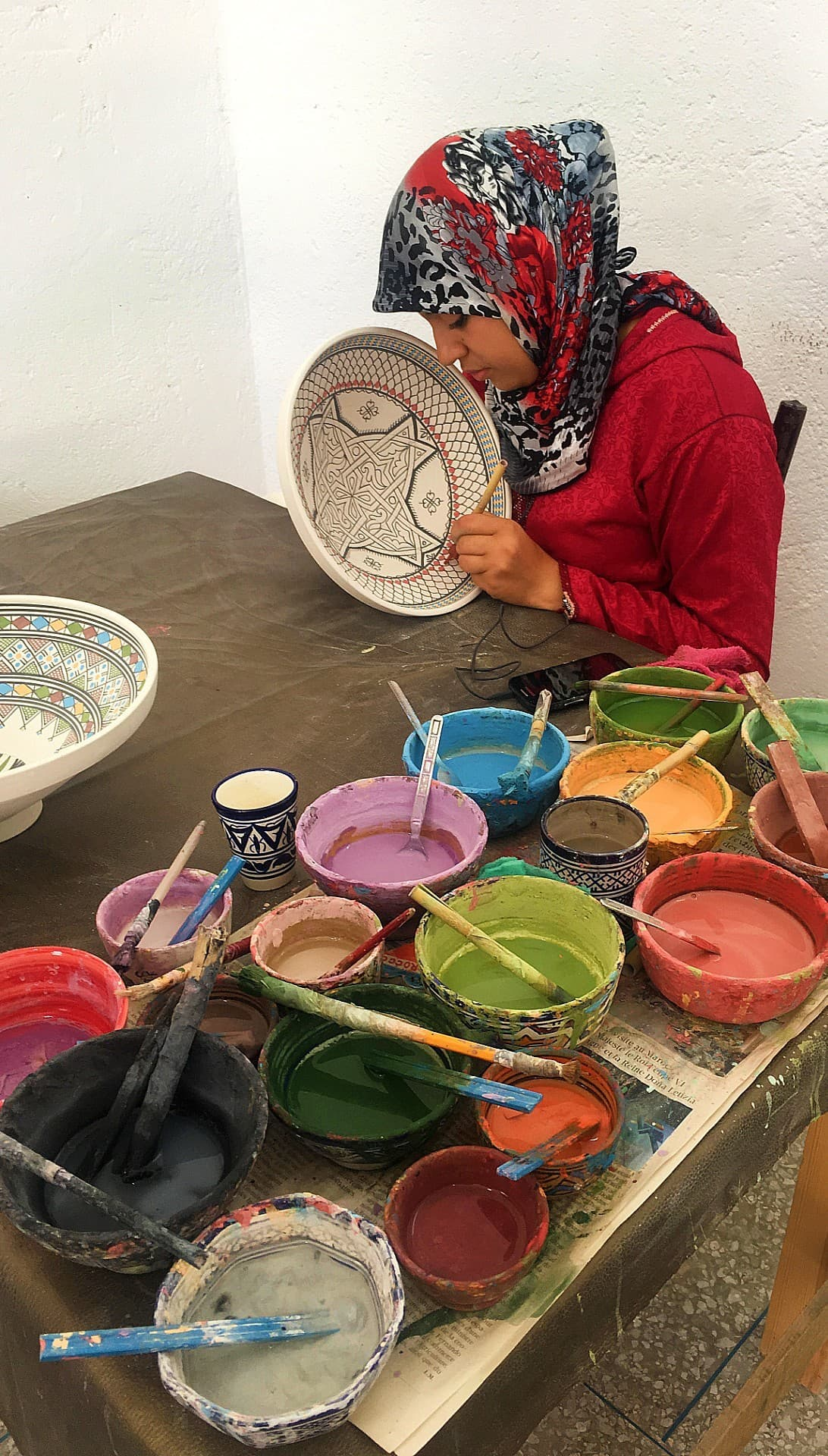 A woman painter at the ceramics workshop.