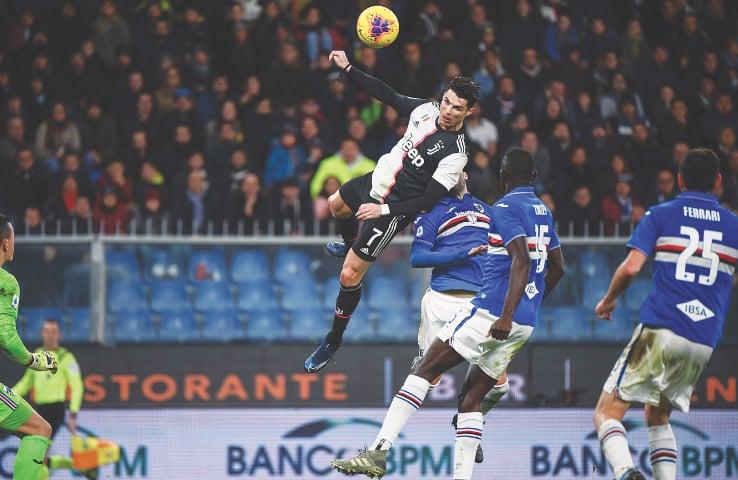 Towering Ronaldo header fires Juve top