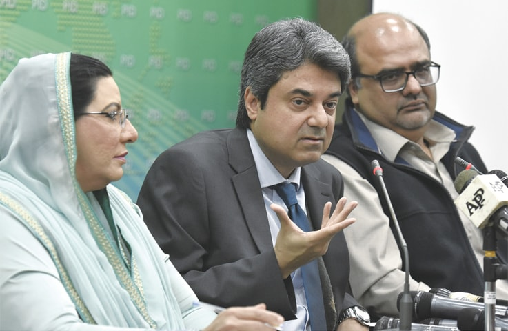 Minister for Law and Justice Dr Farogh Naseem, Special Assistant to the Prime Minister on Accountability Mirza Shahzad Akbar and SAPM on Information Dr Firdous Ashiq Awan addressing a press conference on Thursday.—Tanveer Shahzad / White Star