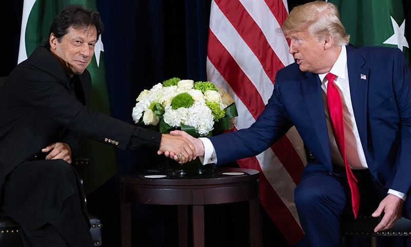 US President Donald Trump shakes hands with Prime Minister Imran Khan during a meeting on the sidelines of the UN General Assembly in New York, September 23. — AFP