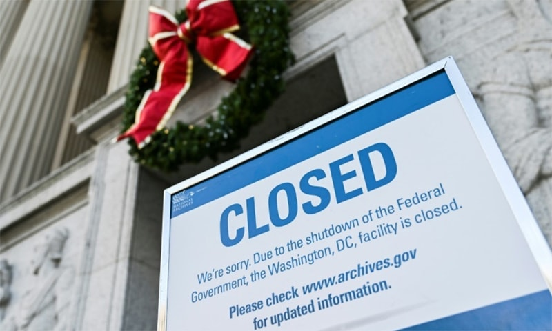 "Washington's National Archives building displays a ""closed"" sign because of the partial US government shutdown. — AFP/File"