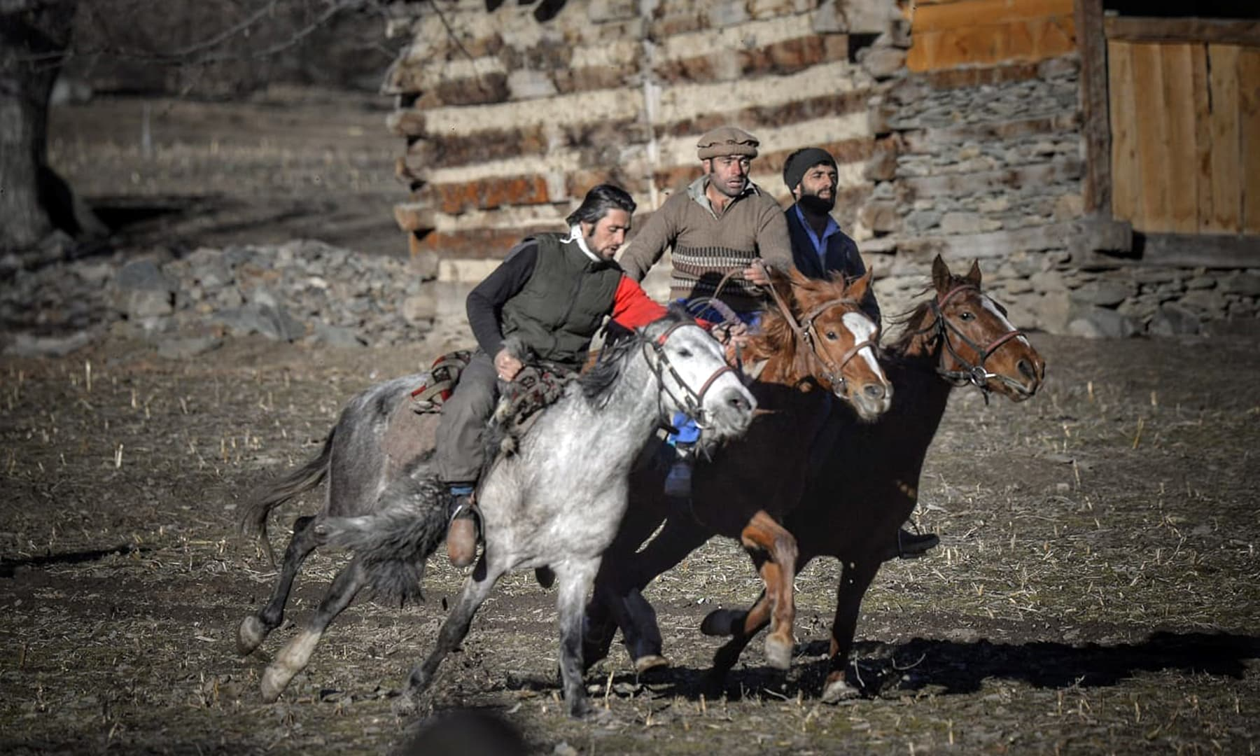 The sport of Buzkashi being played by the Kalasha community members.