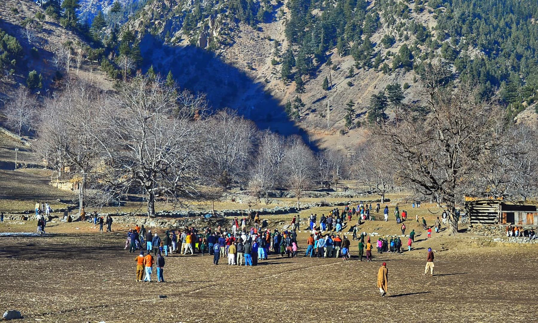 A view of the Kalasha valley where tourists are seen gathering for the day's festivities.