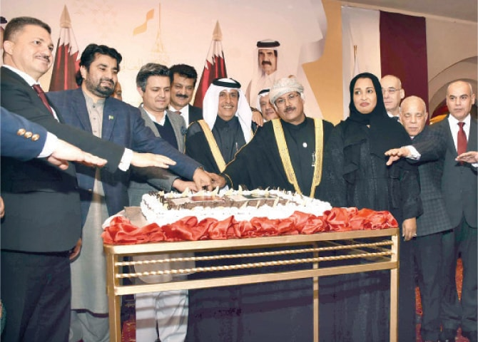 Minister of Economic Affairs Hammad Azhar, Qatari Ambassador Saqr Bin Mubarak Al Mansouri, NA Deputy Speaker Qasim Suri and others cut a cake during the ceremony in Islamabad.