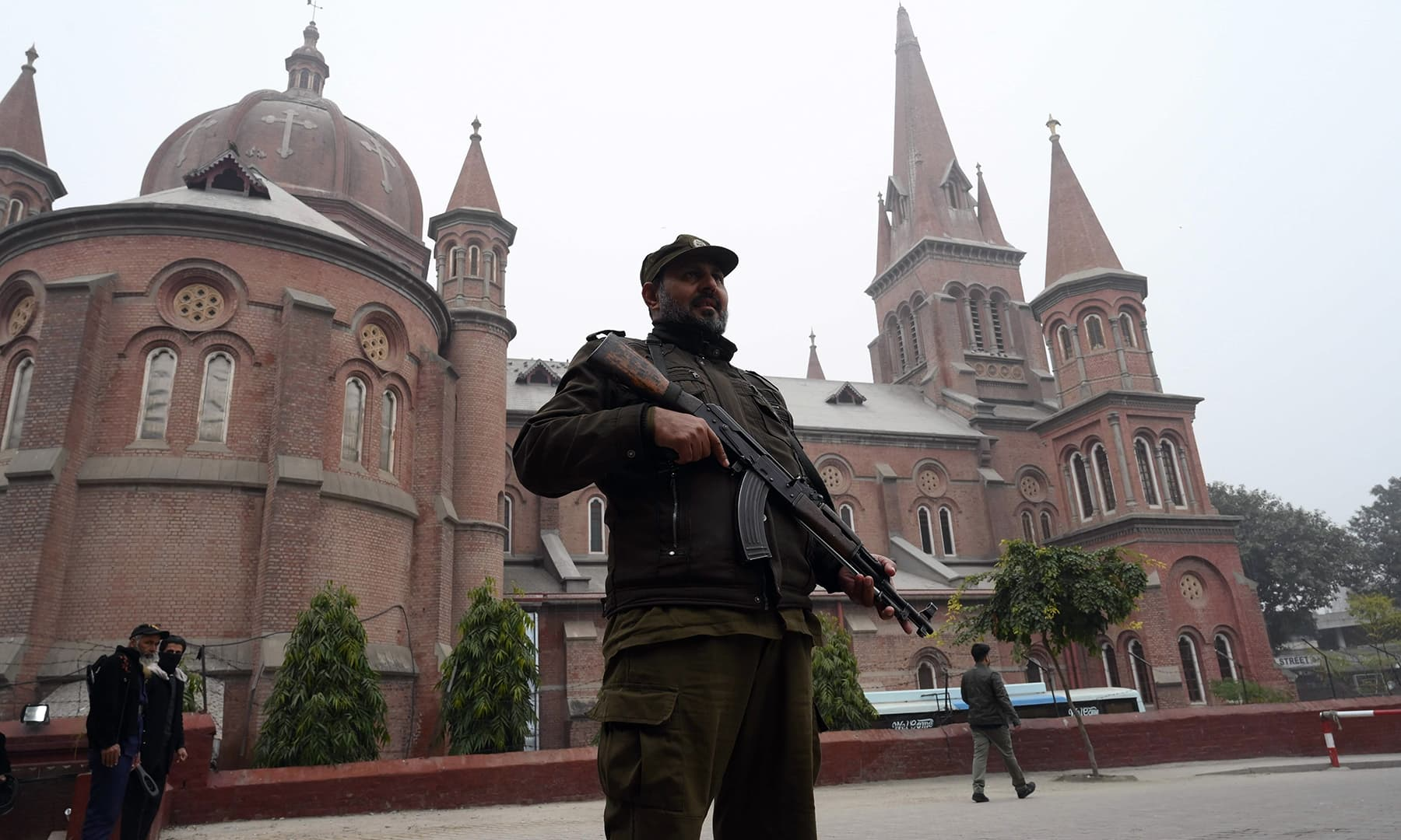 A policeman stands guard during Christmas Day prayers at the Sacred Heart Cathedral Church in Lahore. — AFP