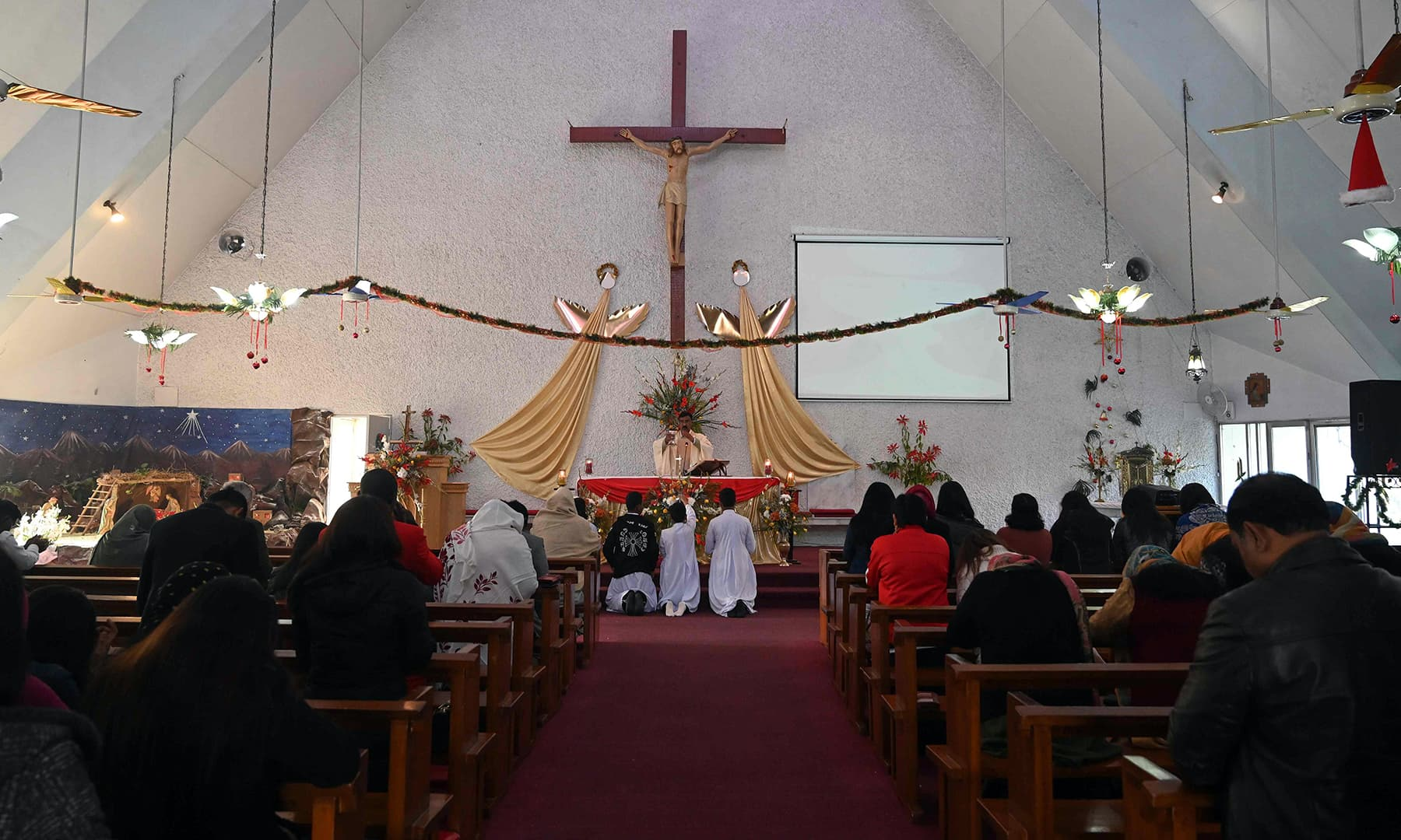 Christian devotees attend Christmas Day prayers at Fatima Church in Islamabad. — AFP