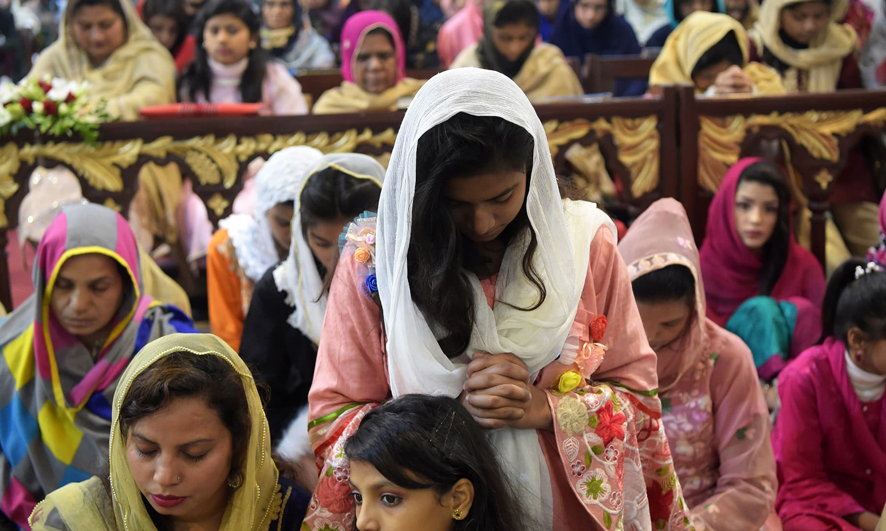 Christian devotees attend Christmas Day prayers at St. John's Cathedral Church in Peshawar. — AFP