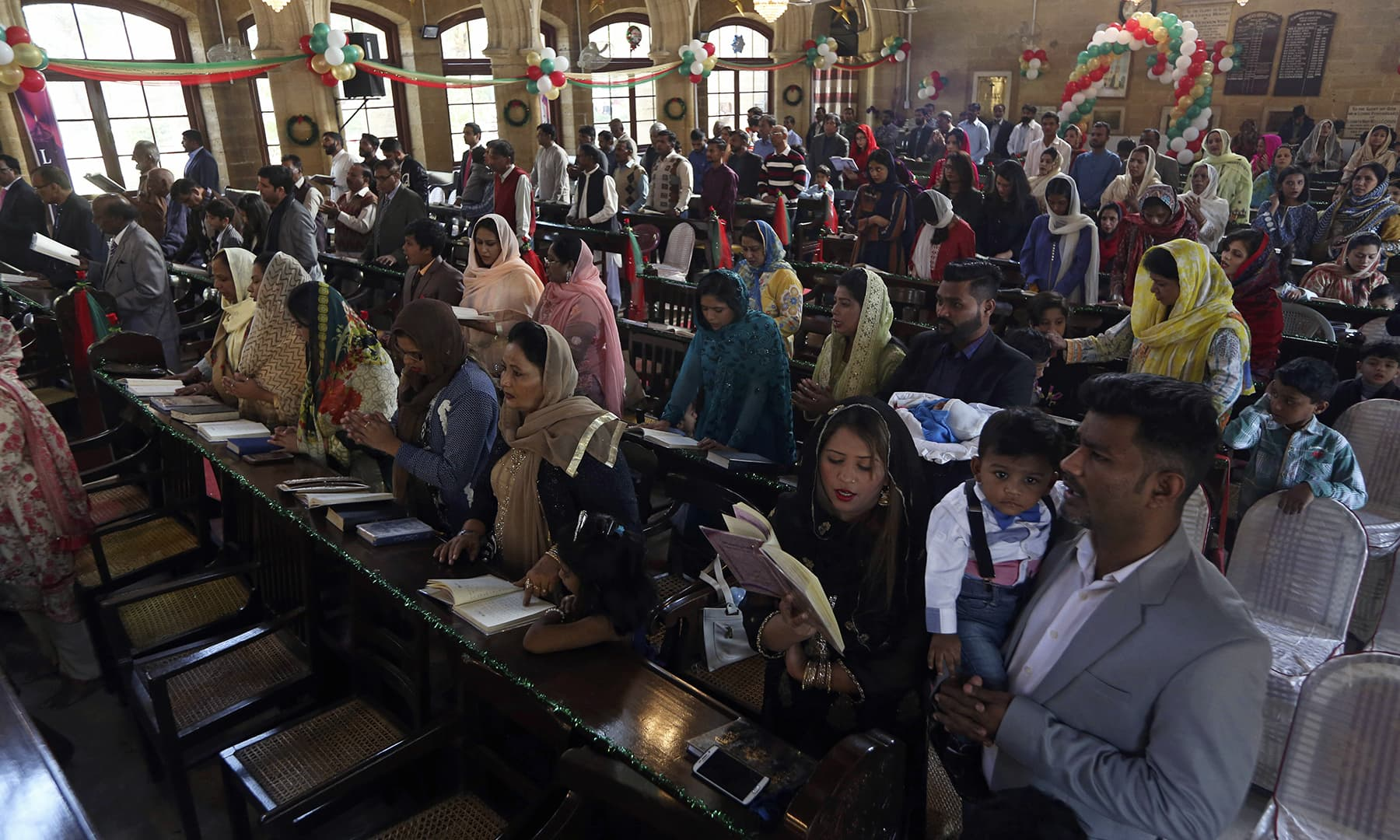 Christians attend Christmas Mass at a church in Karachi, Wednesday. — AP