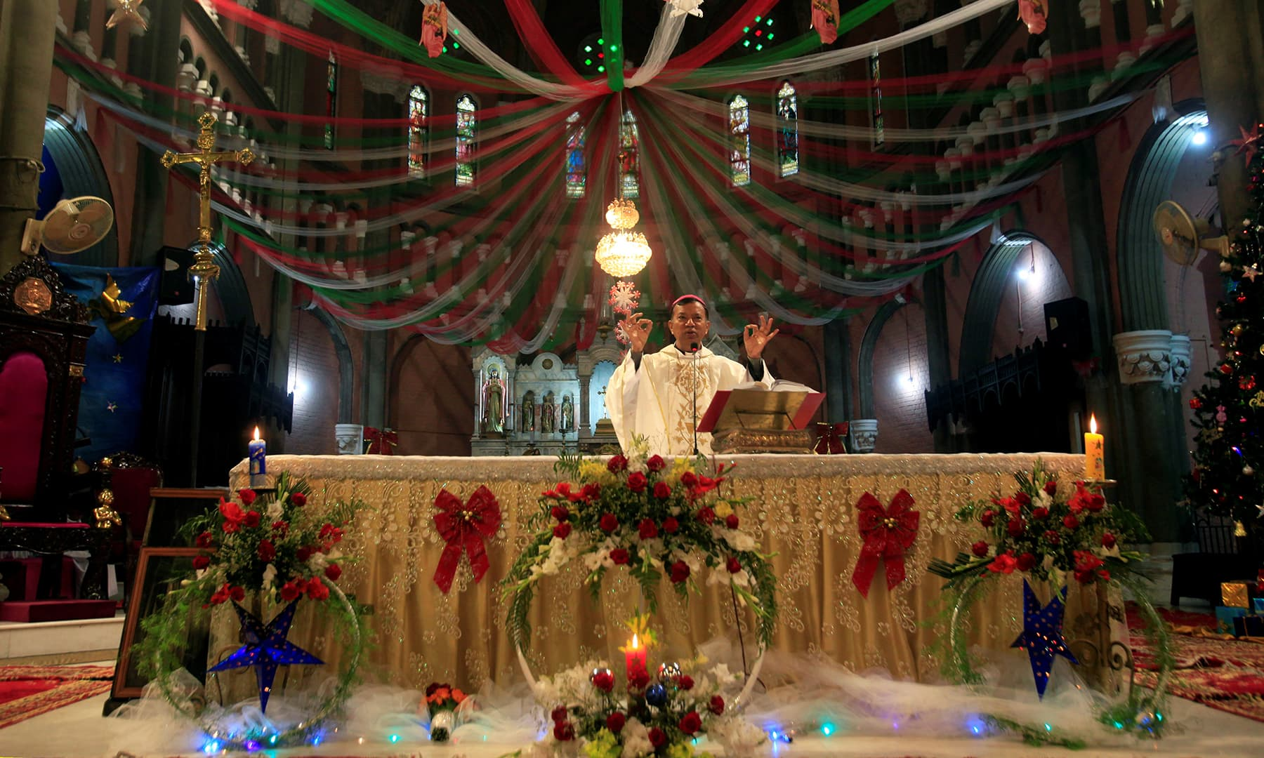 Archbishop Sebastian Shaw leads the Christmas Day service at the Sacred Heart Cathedral in Lahore. — Reuters