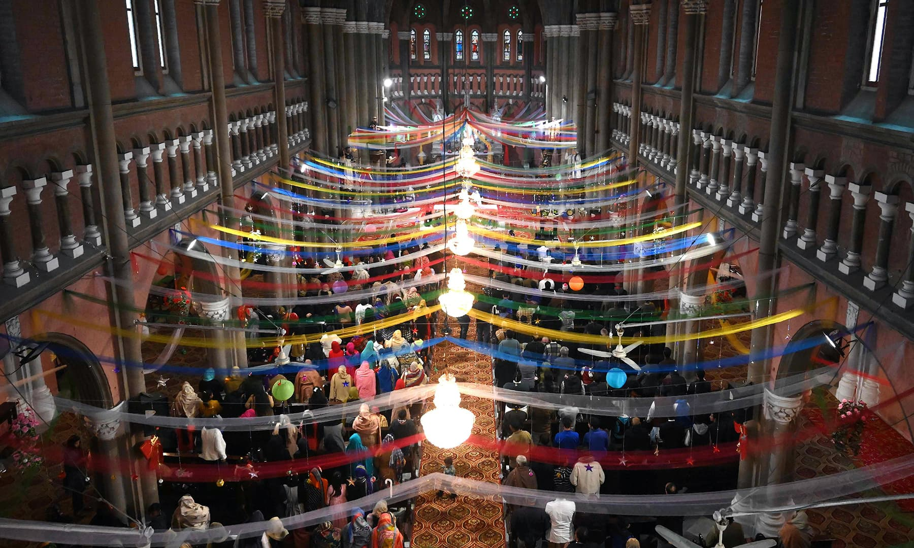 Christian devotees attend Christmas Day prayers at the Sacred Heart Church in Lahore. — AFP